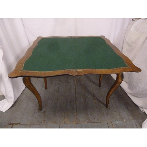 1 - A Victorian rectangular walnut card table, inlaid hinged top on four cabriole legs...