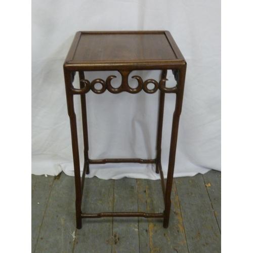 11 - An Oriental hardwood rectangular side table...