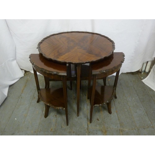 13 - A mahogany circular tea table with four pullout side tables all on outswept legs, A/F...