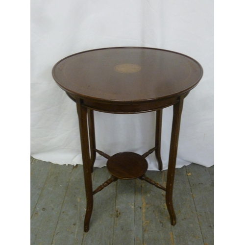14 - An Edwardian mahogany circular side table with satinwood inlay on four tapering legs...