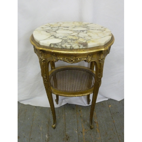 16 - A French oval gilded wood and marble side table on four cabriole legs...