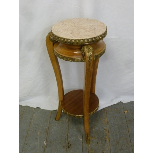 17 - A French style circular side table on three legs with gilt metal mounts and pink marble inset top...