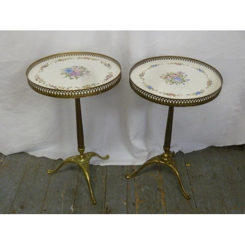 18 - A pair of brass gallery side tables on triform bases...