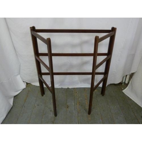 22 - An Edwardian mahogany hinged towel rack...