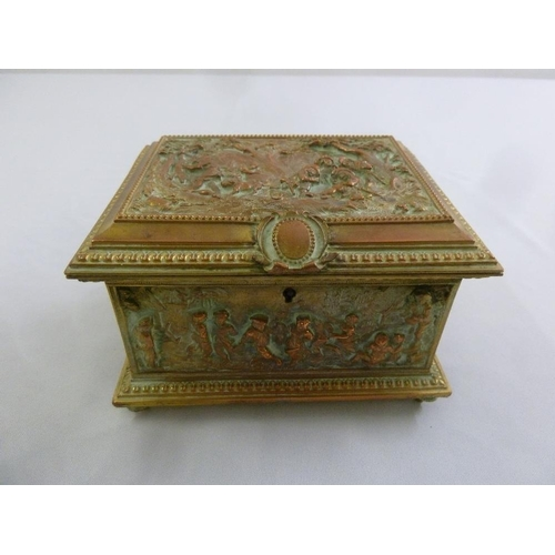 252 - An electrotype brass and copper rectangular casket, the hinged cover and sides embossed with figures...