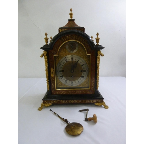 319 - A late 19th century English Boulle chiming bracket clock, the arched top supporting vase form finial...