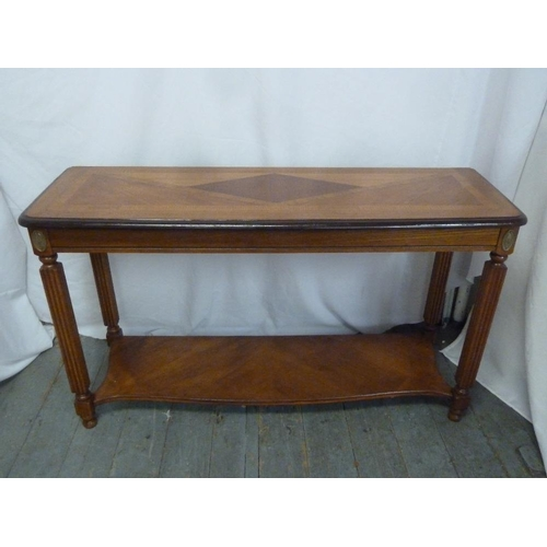 4 - A rectangular mahogany inlaid side table with lower shelf and four fluted cylindrical legs...