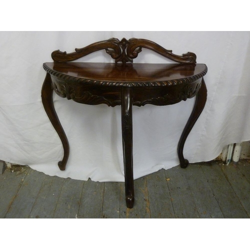 5 - A mahogany D shaped hall table with gadrooned border on three cabriole legs...