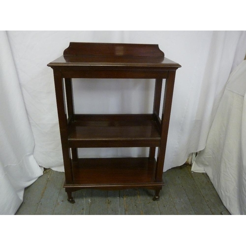 6 - A Victorian rectangular mahogany three tier bookshelf on original brass castors...