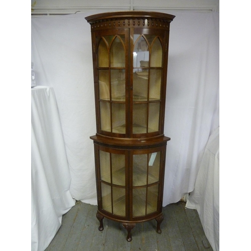 7 - A Victorian mahogany double door glazed breakfront bow fronted corner cabinet...