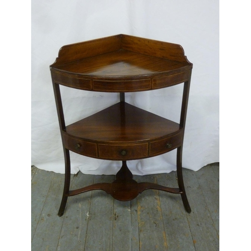 8 - A 19th century mahogany corner wash stand with three drawers and three outswept legs...