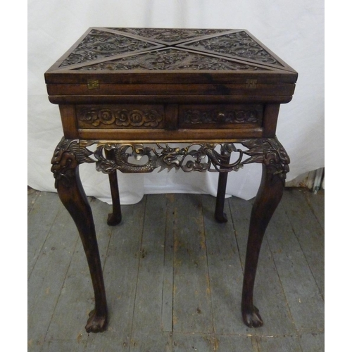 11 - Chinese hardwood envelope card table, heavily carved with dragons and peonies (to include original i...