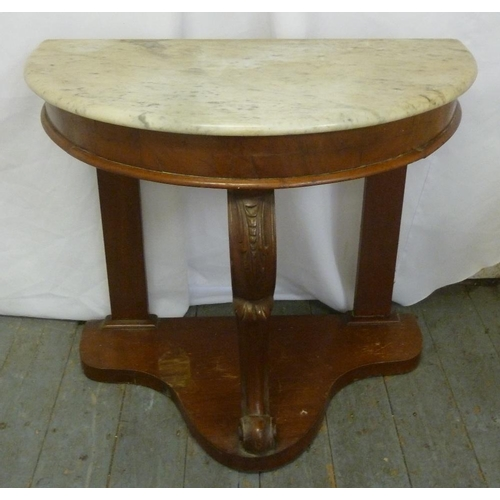 13 - A mahogany marble top hall table on three scrolling supports and triform base...