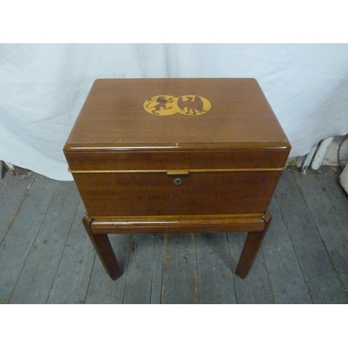 19 - An early 20th century rectangular mahogany work box on stand, the hinged cover inlaid with satinwood...