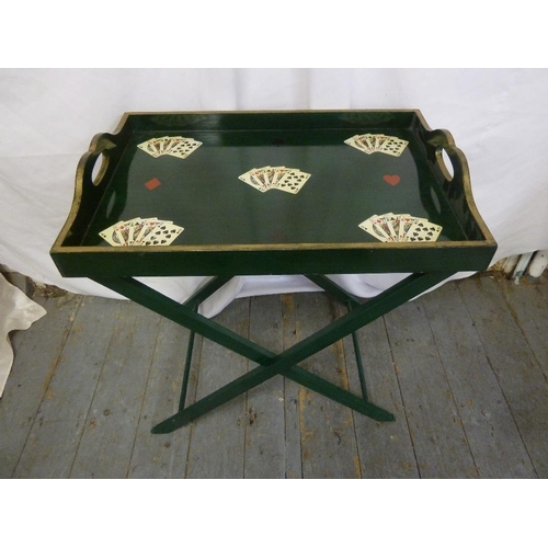 21 - A rectangular lacquered tray on stand decorated with playing cards...