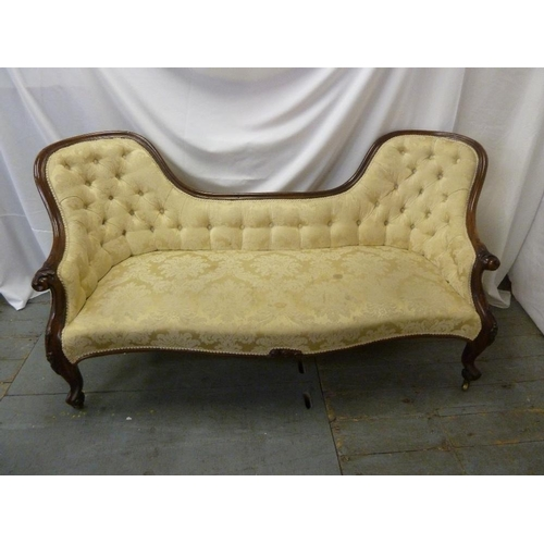22 - A Victorian mahogany upholstered settle on cabriole legs...