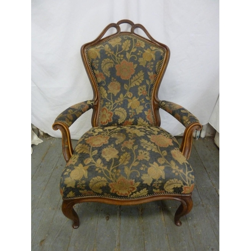 23 - A Victorian upholstered mahogany armchair on cabriole legs...