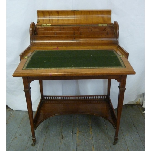 8 - An Edwardian mahogany rectangular writing desk with two drawers on four tapering rectangular legs on...