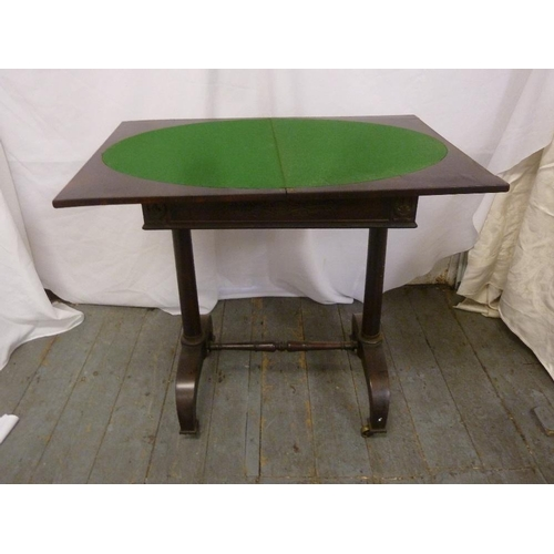 9 - A Victorian mahogany rectangular card table on scrolling supports with original castors...