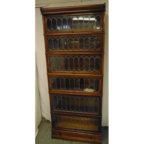 1 - An early 20th century six section Globe Wernicke with lead lined glass panels and bottom drawer plin...