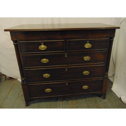 12 - A 19th century rectangular mahogany chest of drawers with brass swing handles on four bracket feet...