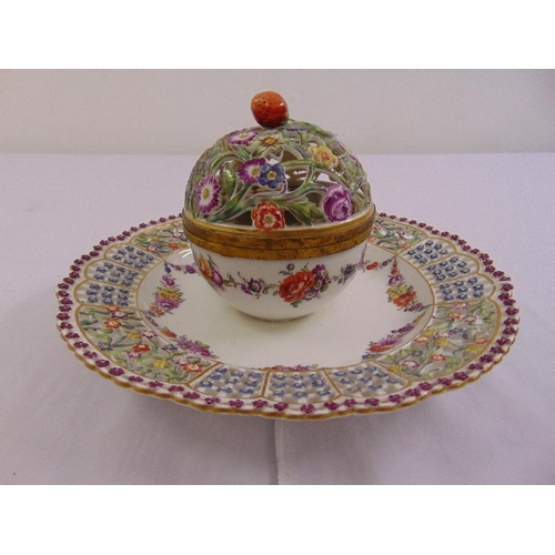 146 - A Meissen circular pierced plate with integrated spherical inkstand, the central inkstand with hinge...