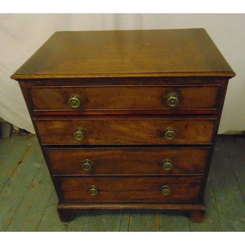 15 - A 19th century rectangular mahogany chest of drawers with brass swing handles on four bracket feet...
