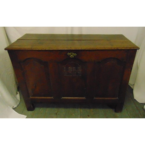 18 - An early 18th century oak coffer carved with the date 1737 on four rectangular supports...