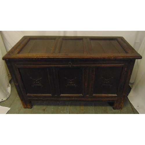 19 - An 18th century rectangular oak coffer, the scroll carved front panels with hinged cover on four bra...