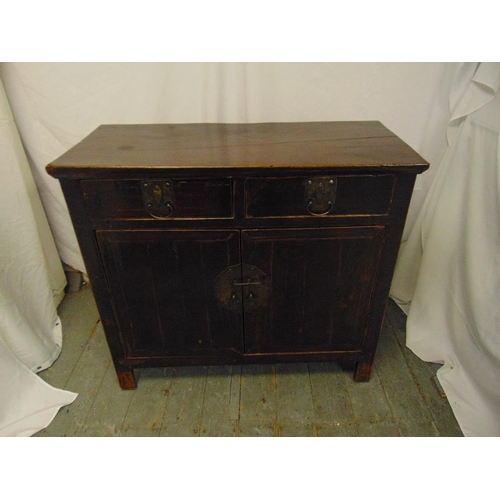 21 - An Oriental rectangular hardwood sideboard with drawers and cupboards on four bracket feet...