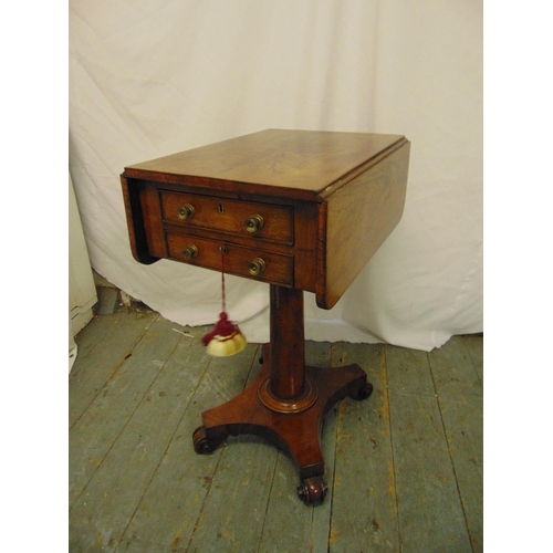 26 - A 19th century rectangular flame mahogany two drawer drop flap side table on columnar stem, shaped q...