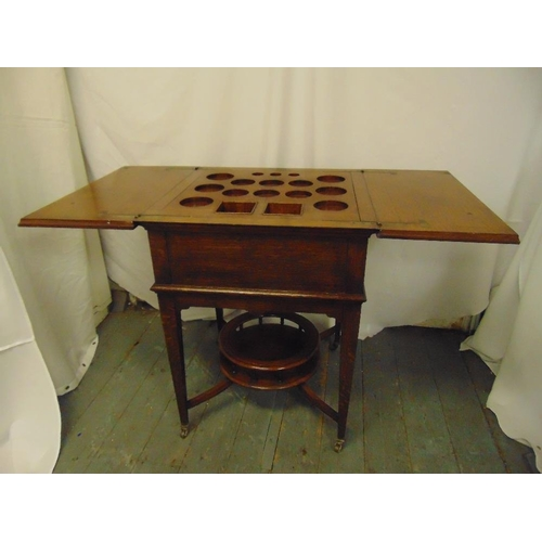 27 - A mahogany rectangular occasional table cum drinks stand, on four tapering rectangular legs...