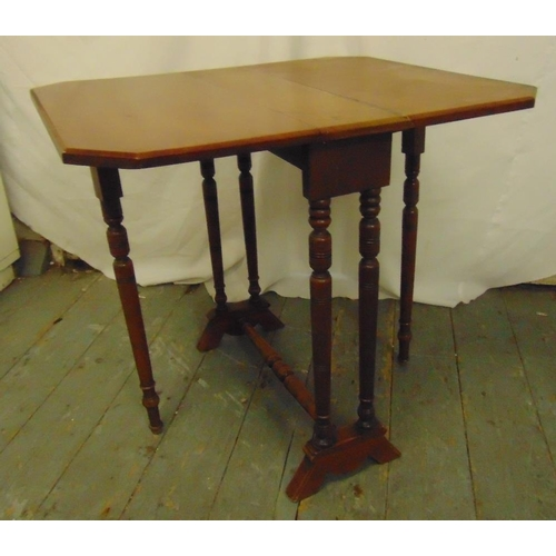 29 - A 19th century rectangular mahogany Sutherland table with turned cylindrical supports...