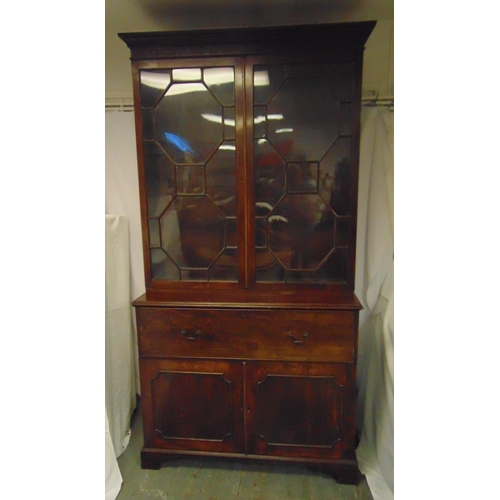 3 - A 19th century rectangular mahogany secretaire bookcase, with hinged glazed doors above four drawers...