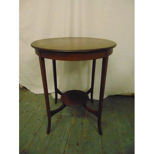 30 - An Edwardian mahogany circular occasional table on tapering rectangular legs...