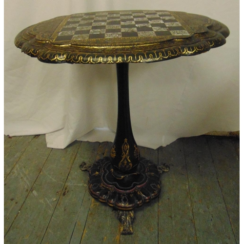 33 - A Victorian ebonised papier mache oval tilt-top games table by Jenners & Bettridge inlaid with abalo...