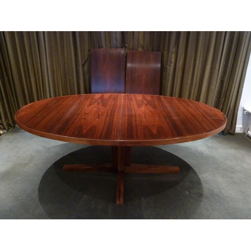 34 - Doumas Danish rosewood oval pedestal dining table with two drop in inserts, CITES certificate includ...