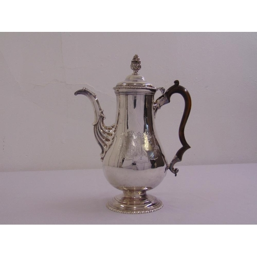 344 - A George III Irish silver coffee pot, the pear shaped body with leaf capped fluted scrolling spout, ...