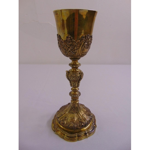 346 - A 19th century continental silver gilt chalice, the knopped stem chased with scrolls acanthus leaves...