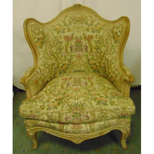 36 - A French style upholstered armchair on four scroll legs...