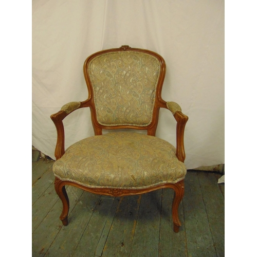 38 - A French style mahogany upholstered armchair on four cabriole legs...