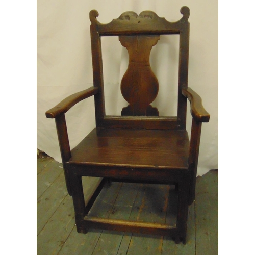 42 - An early 18th century oak chair with central splat, open arms and canted square legs...