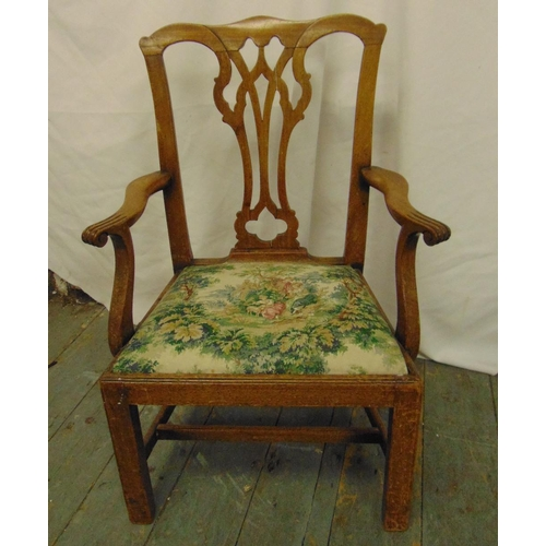 44 - A George III mahogany childs chair with pierced splat, tapestry seat on four rectangular legs...