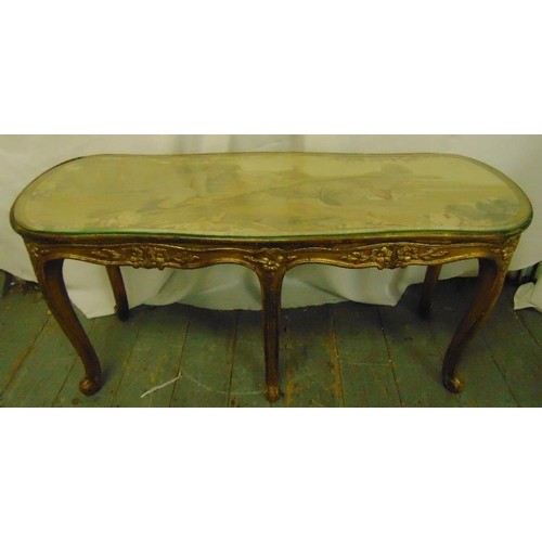46 - A salon table rounded rectangular carved gilt wood sides and cabriole legs with tapestry top...