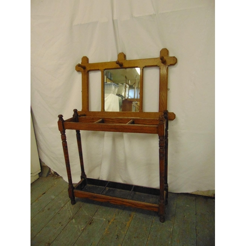 49 - A rectangular oak wall mounted hat and coat rack and an umbrella stand...