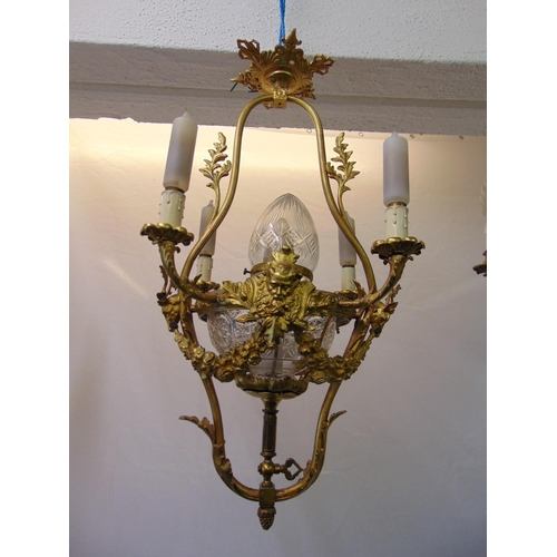 58 - A Victorian gilded metal four branch chandelier with cut glass central bowl...