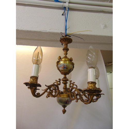 59 - A gilded metal five branch chandelier with painted porcelain panels and cast caryatids...