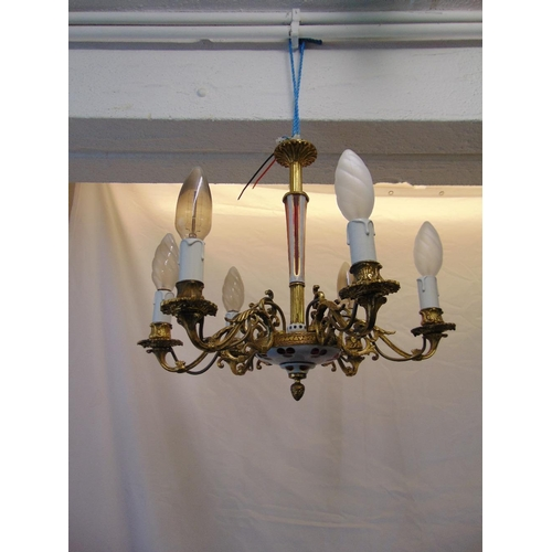 60 - A gilded metal six branch chandelier with red overlaid glass detail...