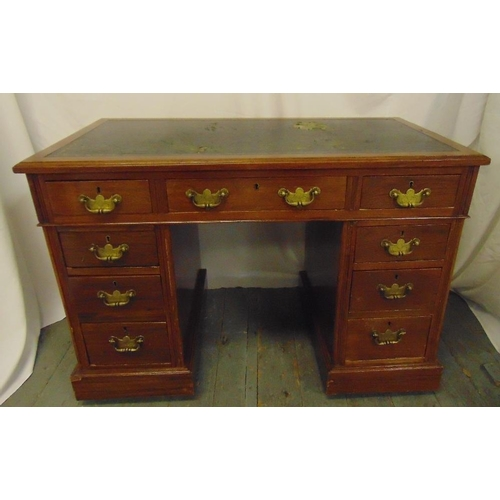 2 - An Edwardian rectangular mahogany kneehole desk with inset tooled leather top and brass swing handle...