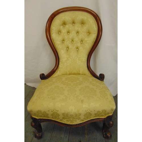 21 - A Victorian spoon back upholstered salon chair with carved hardwood frame and button back...